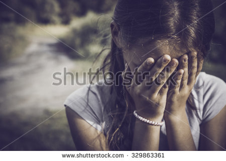 stock-photo-close-up-portrait-of-a-girl-crying-and-covering-her-face-329863361