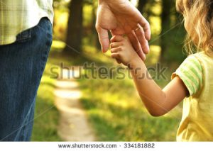 stock-photo-the-parent-holds-the-hand-of-a-small-child-334181882