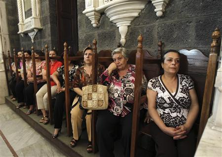 Syrian women attend mass in the Catholic Patriarchate in Damascus, September 7, 2013. REUTERS/Khaled al Hariri