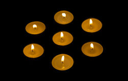 seven-candles-burning-black-background-45741898