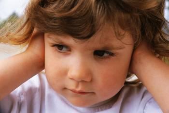 Little Girl Covering Ears ca. 2000