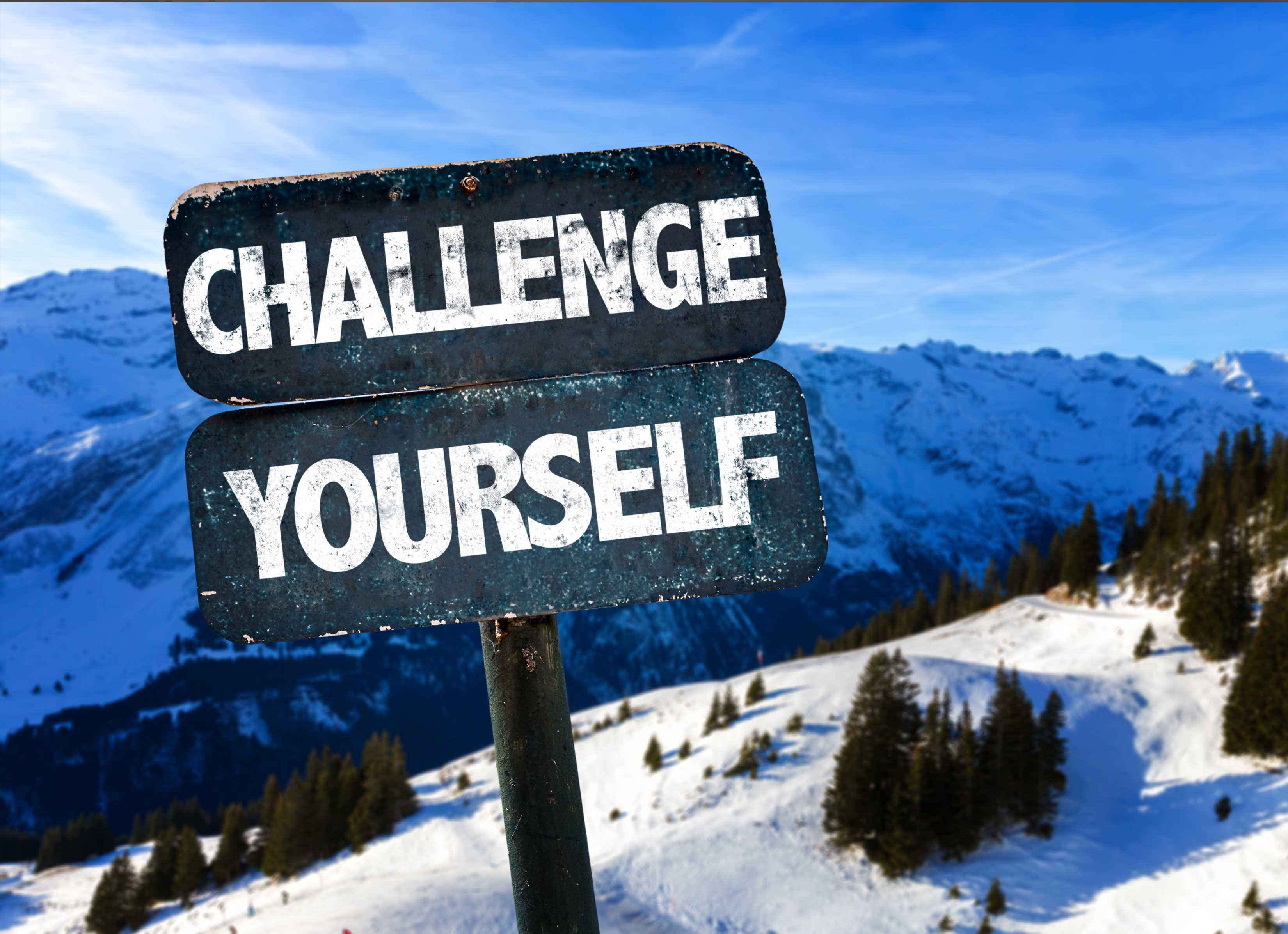 Challenge Yourself sign with sky background
