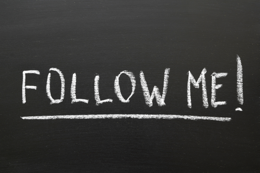 follow me phrase handwritten on school blackboard