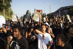 TORONTO, ON- JULY 27 - Josh Cedro (centre right), 16, chants with the crowd during Black Lives Matter protest that marched from Gilbert Avenue to Allen Road on Eglinton Avenue. The protest shut down the southbound Allen Road for around 30 minutes, causing traffic to reverse and exit through Lawrence Avenue.        (Melissa Renwick/Toronto Star via Getty Images)
