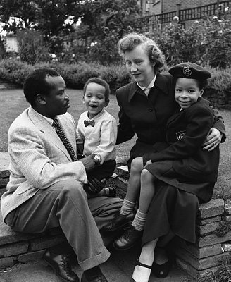 1956, London, England, UK --- Seretse Khama, later the first President of Botswana when it gained independence, with his wife Ruth, and children in the garden of their Croydon home. --- Image by © Hulton-Deutsch Collection/CORBIS