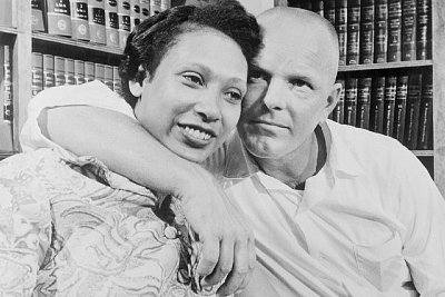 12 Jun 1967, Washington, DC, USA --- The Supreme Court ruled unanimously that a Virginia law banning marriage between African Americans and Caucasians was unconstitutional, thus nullifying similar statues in 15 other states. The decision came in a case involving Richard Perry Loving, a white construction worker and his African American wife, Mildred. The couple married in the District of Columbia in 1958 and were arrested upon their return to their native Caroline County, Virginia. They were given one year suspended sentences on condition that they stay out of the state for 25 years. The Lovings decided in 1963 to return home and fight banishment, with the help of the American Civil Liberties Union. --- Image by © Bettmann/CORBIS