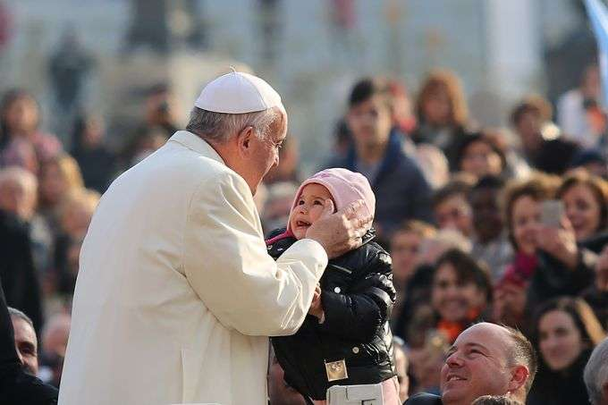 pope_francis_kisses_a_child_1_in_st_peters_square_for_the_general_audience_dec_9_2015_credit_daniel_ibanez_cna_12_9_15