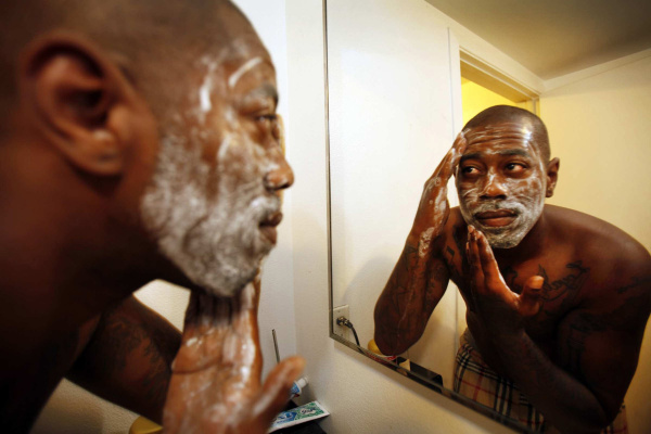 Marquez Briggs, 30, uses a foaming scrub cleanser during his morning routine on Monday June 18, 2012 as mens grooming products are gaining popularity. (Al Seib/Los Angeles Times/MCT)