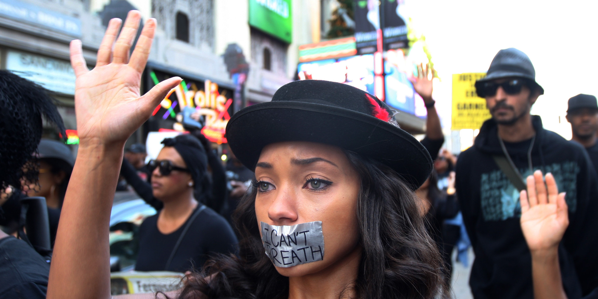 LOS ANGELES, CA - DECEMBER 6:  People march on Hollywood Boulevard in protest of the decision in New York not to indict a police officer involved in the choke-hold death of Eric Garner on December 6, 2014 in the Hollywood section of Los Angeles, California. The march passes the tourist attraction of Hollywood and Highland where, by coincidence, police shot and killed a man in the intersection. Police say that he had a knife.   (Photo by David McNew/Getty Images)