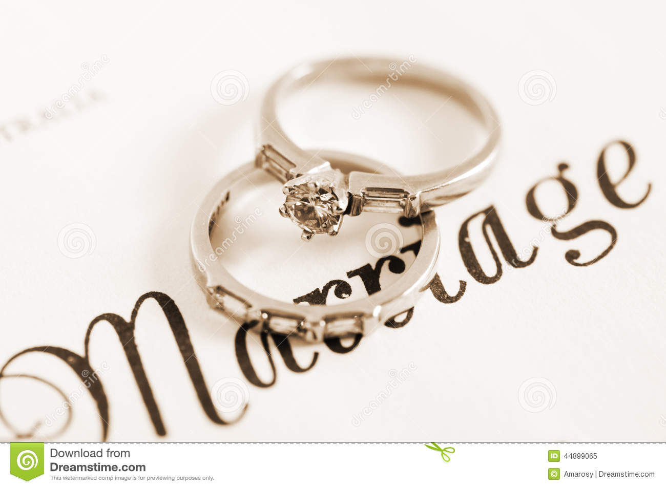 sepia-vintage-retro-style-wedding-diamond-engagement-rings-marriage-certificate-closeup-macro-44899065