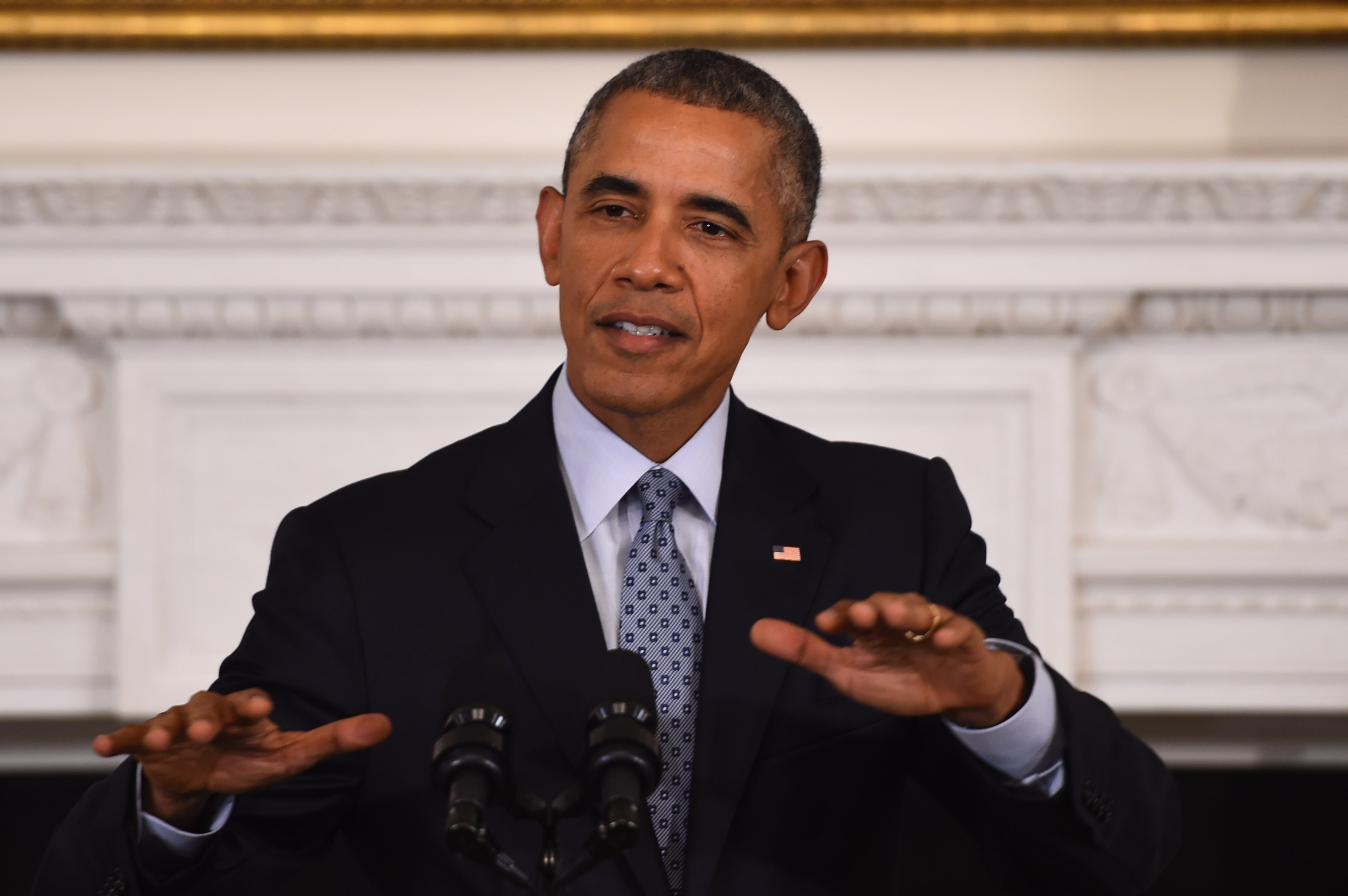 """US President Barack Obama speaks during a press conference at the White House on October 2, 2015, in Washington, DC. Obama warned Friday that Russia's military engagement in Syria in support of strongman Bashar al-Assad is a """"recipe for disaster,"""" though Washington could still work with Moscow on reducing tensions. AFP PHOTO/JIM WATSON (Photo credit should read JIM WATSON/AFP/Getty Images)"""