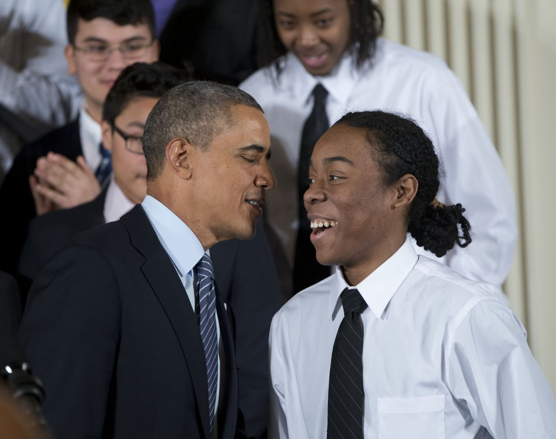 President Barack Obama speaks with Christian Champagne, 18, a senior at Hyde Park Career Academy in Chicago, who introduced him before launching a new initiative to provide greater opportunities for young black and Hispanic men called 'My Brother's Keeper' Thursday, Feb. 27, 2014, in the East Room of the White House in Washington. The White House is partnering with businesses, nonprofits and foundations to address disparities in education, criminal justice and employment. (AP Photo/Pablo Martinez Monsivais)